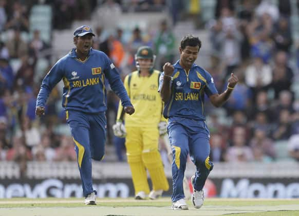 Nuwan Kulasekera, right, celebrates after taking the wicket of Australia's Shane Watson clean bowled during their ICC Champions Trophy cricket match at the Oval cricket ground in London.