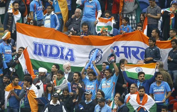 India fans watch the cricket during an ICC Champions Trophy semifinal between India and Sri Lanka at the Cardiff Wales Stadium in Cardiff.