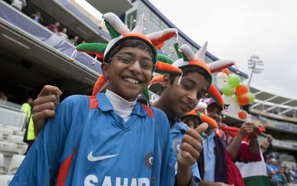 India fans wait for play for play before the team's ICC Champions Trophy Final cricket match against England at Edgbaston cricket ground, Birmingham..