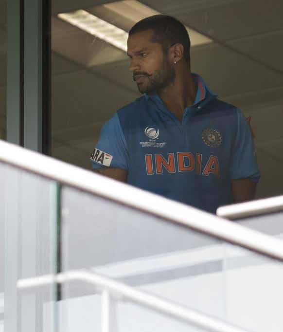 Shikhar Dhawan looks out from the dressing room as rain falls at Edgbaston cricket ground before his team's ICC Champions Trophy Final cricket match against England.