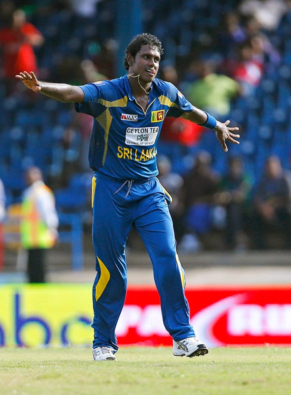 Sri Lanka captain Angelo Mathews celebrates after bowling out West Indies' Jason Holder for a duck during their Tri-Nation Series cricket match in Port-of-Spain, Trinidad.