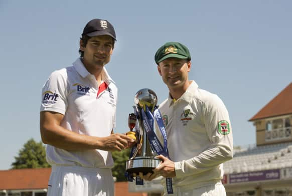 England's captain Alastair Cook and Australia captain Michael Clarke pose for pictures with a replica of the Ashes urn, left, and the series trophy the day before the opening Ashes cricket match at Trent Bridge cricket ground, Nottingham.