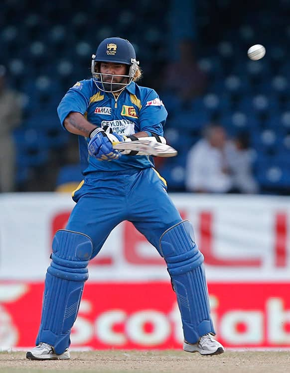 Sri Lanka's Lasith Malinga drives a delivery off India's Umesh Yadav to be caught by Ravindra Jadeja for seven runs during their Tri-Nation Series cricket match in Port-of-Spain, Trinidad.