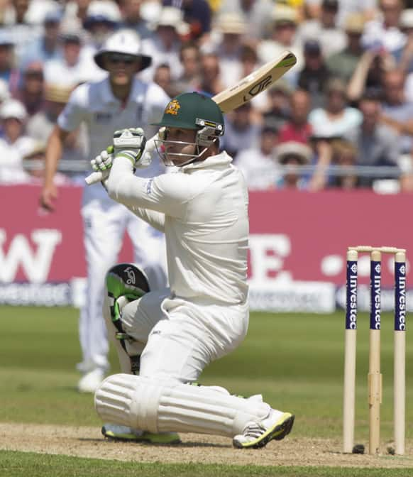 Australia's Phillip Hughes plays a shot off the bowling of England's Steven Finn on the second day of the opening Ashes series cricket match at Trent Bridge cricket ground, Nottingham, England.