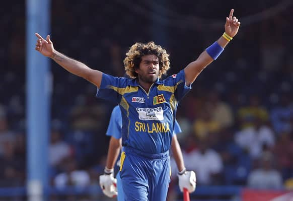 Sri Lanka fast bowler Lasith Malinga celebrates after trapping India's Bhuvneshwar Kumar LBW for a duck during the final match of the Tri-Nation cricket series in Port-of-Spain, Trinidad.