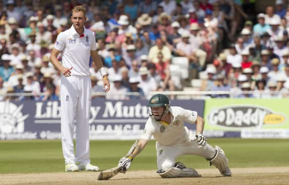 Australia's Chris Rogers makes his ground as he takes a run off the bowling of England's Stuart Broad on the fourth day of the opening Ashes series cricket match at Trent Bridge cricket ground, Nottingham, England.