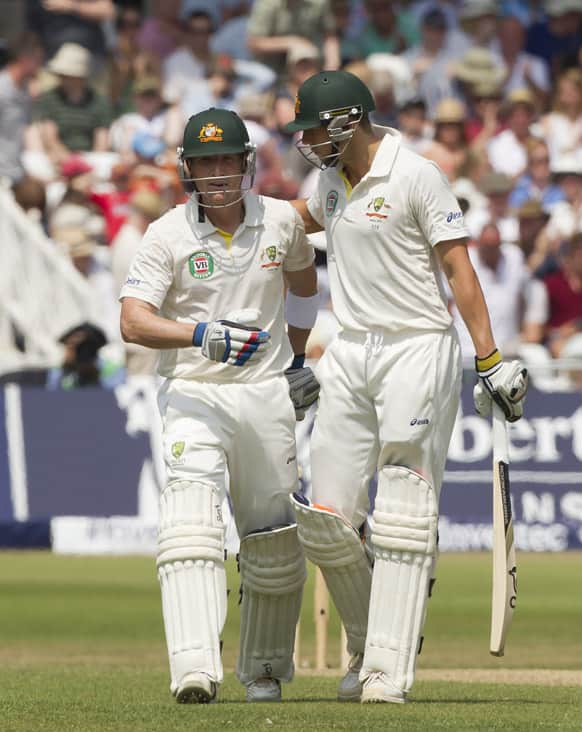 Australia's Brad Haddin, left, and James Pattinson walk from the pitch at lunch on the final day of the opening Ashes series cricket match against England at Trent Bridge cricket ground, Nottingham.