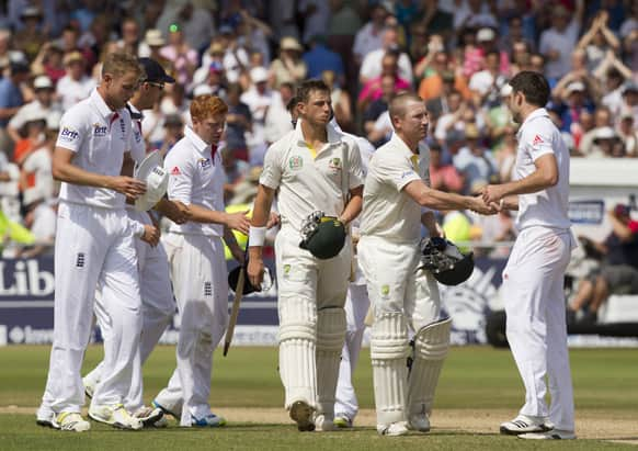 England's James Anderson, right, shakes hands with Australia's Brad Haddin, far right, after taking the final wickets as his side win by 14 runs on the final day of the opening Ashes series cricket match at Trent Bridge cricket ground.