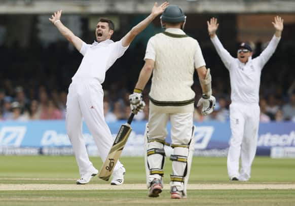 England's James Anderson, left, appeals successfully the LBW of Australia's Shane Watson during day four of the second Ashes Test match held at Lord's cricket ground in London.