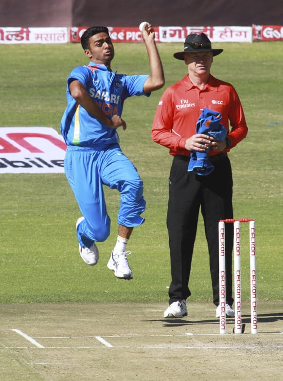 Jaidev Unadkat bowls on the third day of the cricket match against Zimbabwe in Harare.