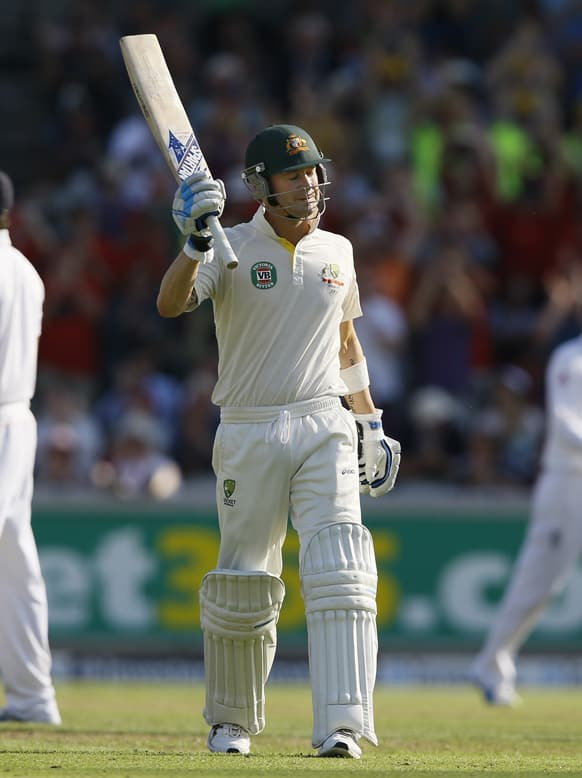 Australia's Michael Clarke holds up his bat after getting his century during day one of the third Ashes Test match held at Old Trafford cricket ground in Manchester, England.