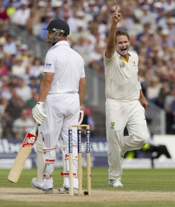 Australia's Ryan Harris celebrates after taking the wicket of England's Jonathan Trott on the third day of the third Ashes Test series cricket match at Old Trafford cricket ground, Manchester, England.