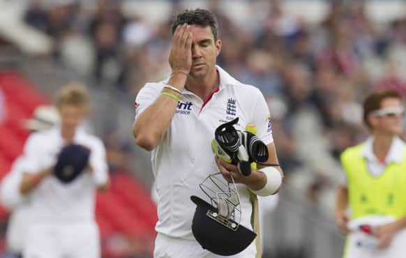 England's Kevin Pietersen reacts after an unsuccessful decision review as he walks from the pitch after losing his wicket, caught by Brad Haddin for 8 off the bowling of Australia's Peter Siddle, on the final day of the third Ashes Test series cricket match at Old Trafford cricket ground, Manchester