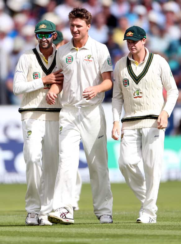 Australia's Jackson Bird, center, celebrates after bowling out England's James Anderson during the second day of the fourth Ashes series cricket match at the Riverside cricket ground, Chester-le-Street, England.