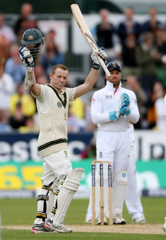 Australia's Chris Rogers celebrates scoring 100 during the second day of the fourth Ashes series cricket match against England at the Riverside cricket ground, Chester-le-Street, England.