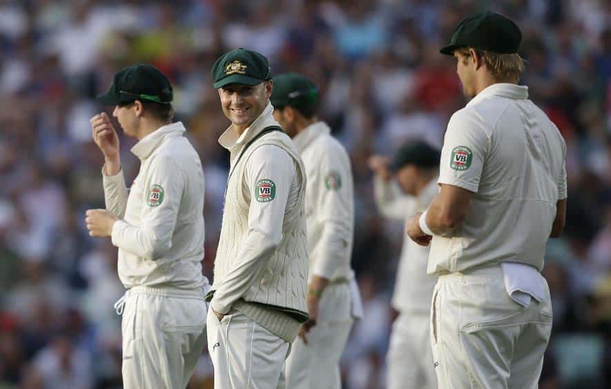 Australia's cricket captain Michael Clarke, second right, smiles as he turns to speak to teammate Shane Watson, left, during play on the second day of the fifth Ashes cricket Test at the Oval cricket ground in London.