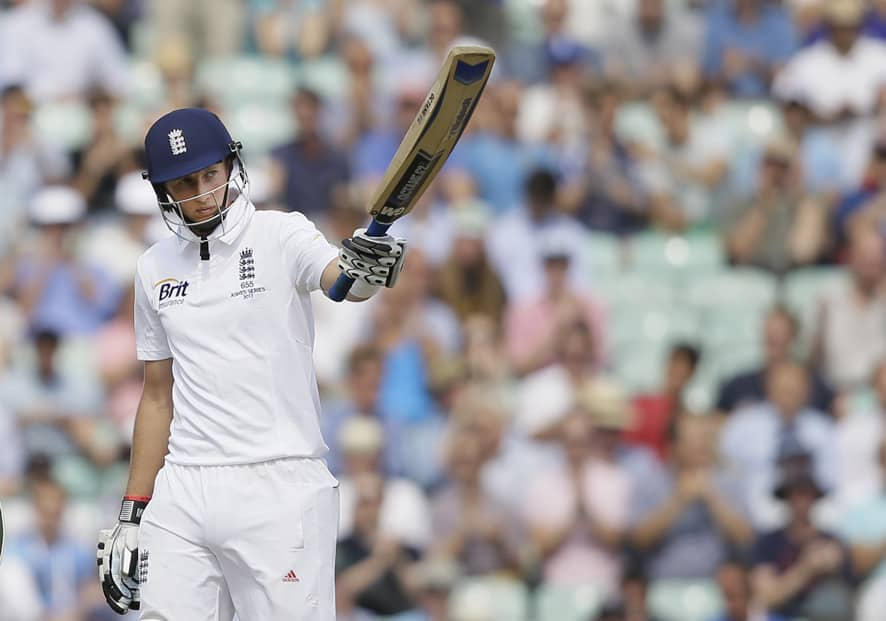 England's Joe Root celebrates his 50 runs not out during play on the third day of the fifth Ashes cricket Test against Australia at the Oval cricket ground in London.