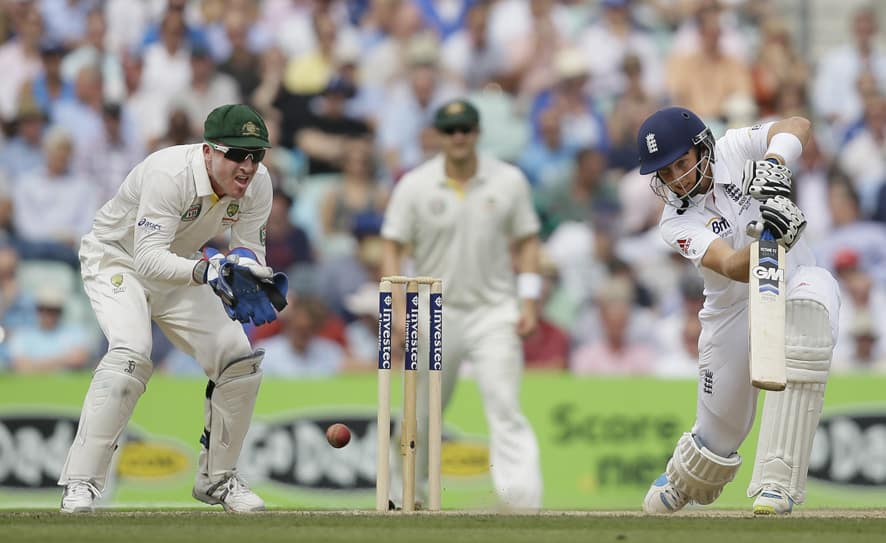 England's Joe Root plays a shot from the bowling of Australia's Nathan Lyon during play on the third day of the fifth Ashes cricket Test at the Oval cricket ground in London.