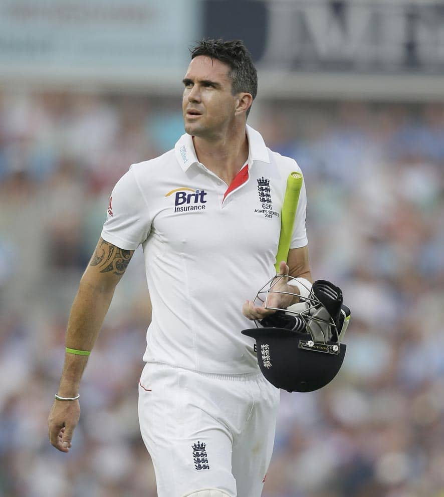 England's Kevin Pietersen walks off the pitch after being given out caught by Australia's Shane Watson off the bowling of Mitchell Starc during play on the third day of the fifth Ashes cricket Test at the Oval cricket ground in London.