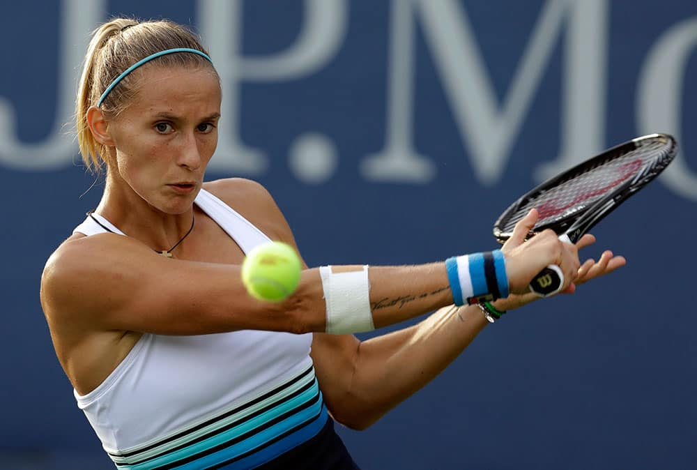 Slovenia's Polona Hercog returns a shot to Ekaterina Makarova, of Russia, during the first round of the 2013 US Open tennis tournament.