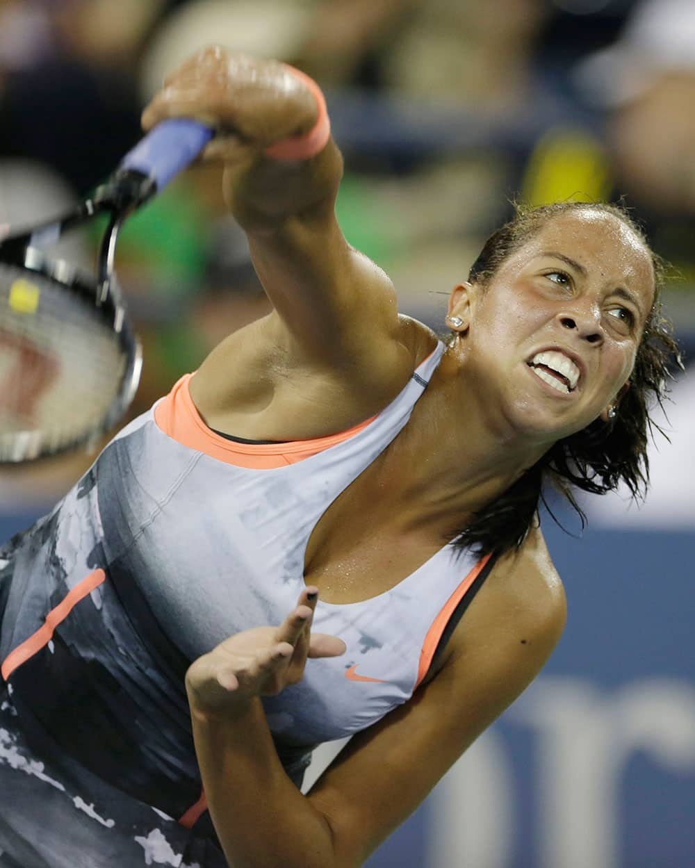 Madison Key serves to Serbia's Jelena Jankovic during the opening round of the US Open tennis tournament.