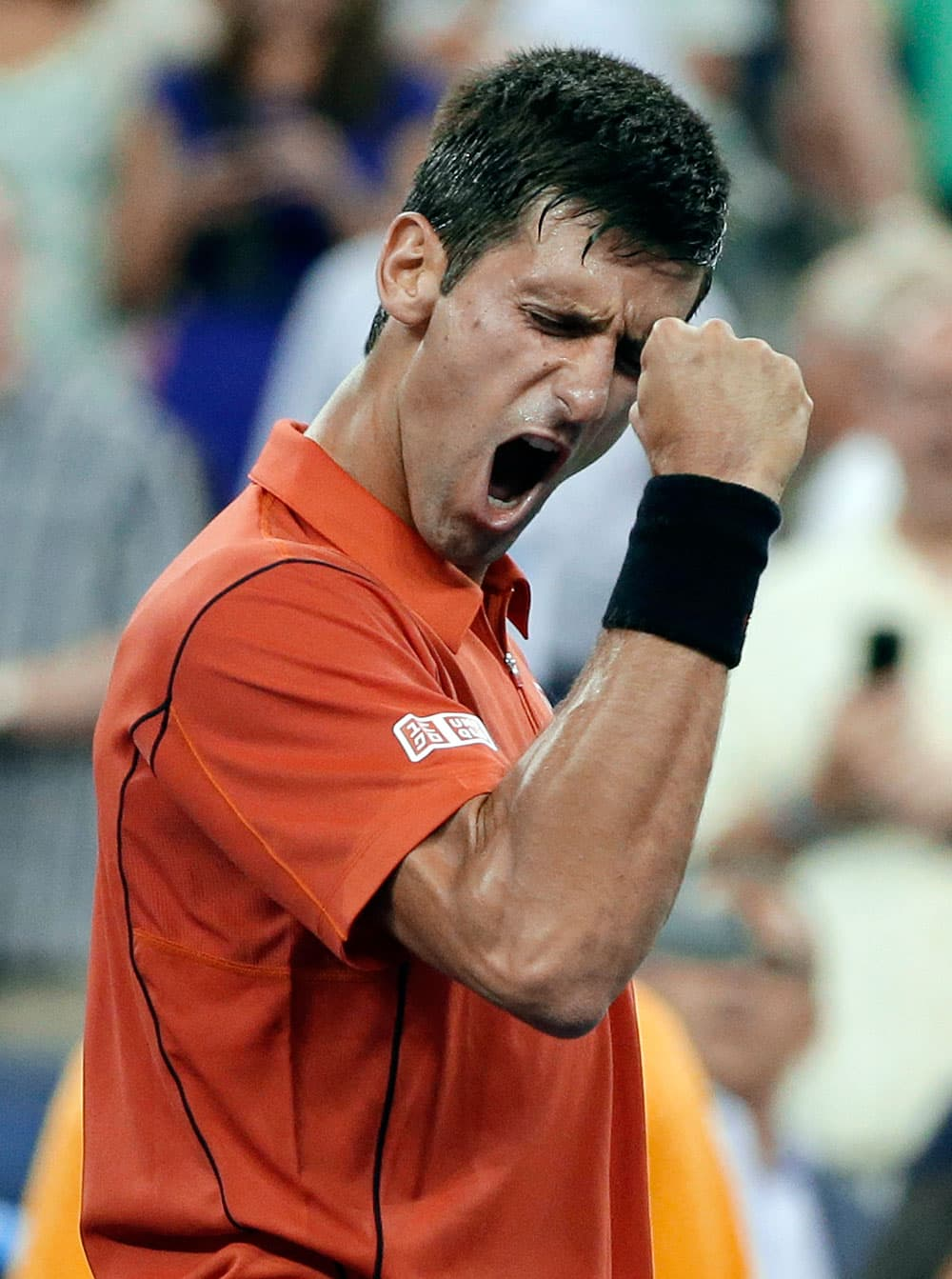 Novak Djokovic, of Serbia, reacts after defeating Ricardas Berankis, of Lithuania, in a first round of the US Open tennis tournament.