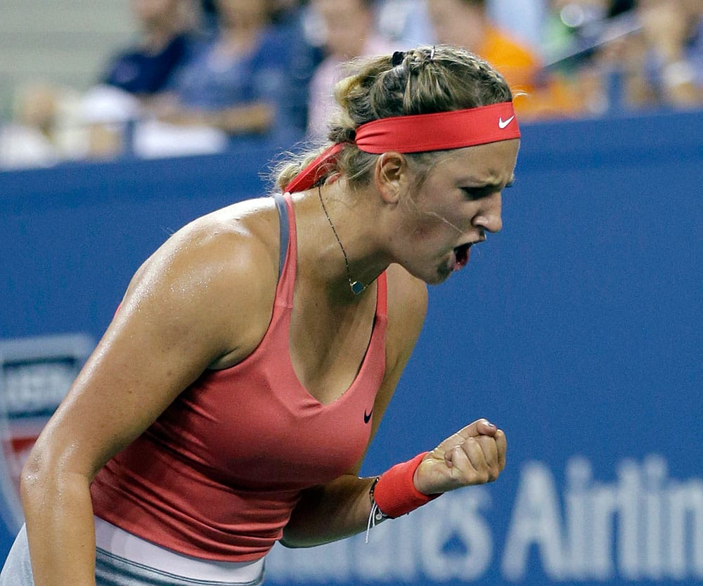 Belarus's Victoria Azarenka reacts during her match against Germany's Dinah Pfizenmaier in the first round of the US Open tennis tournament.