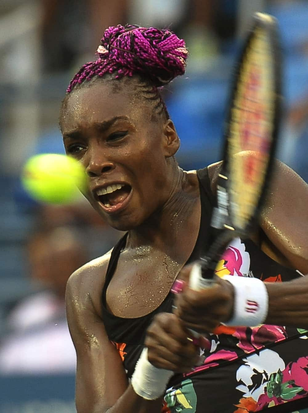 Venus Williams returns a shot to Jie Zheng, of China, during the second round of the 2013 US Open tennis tournament.
