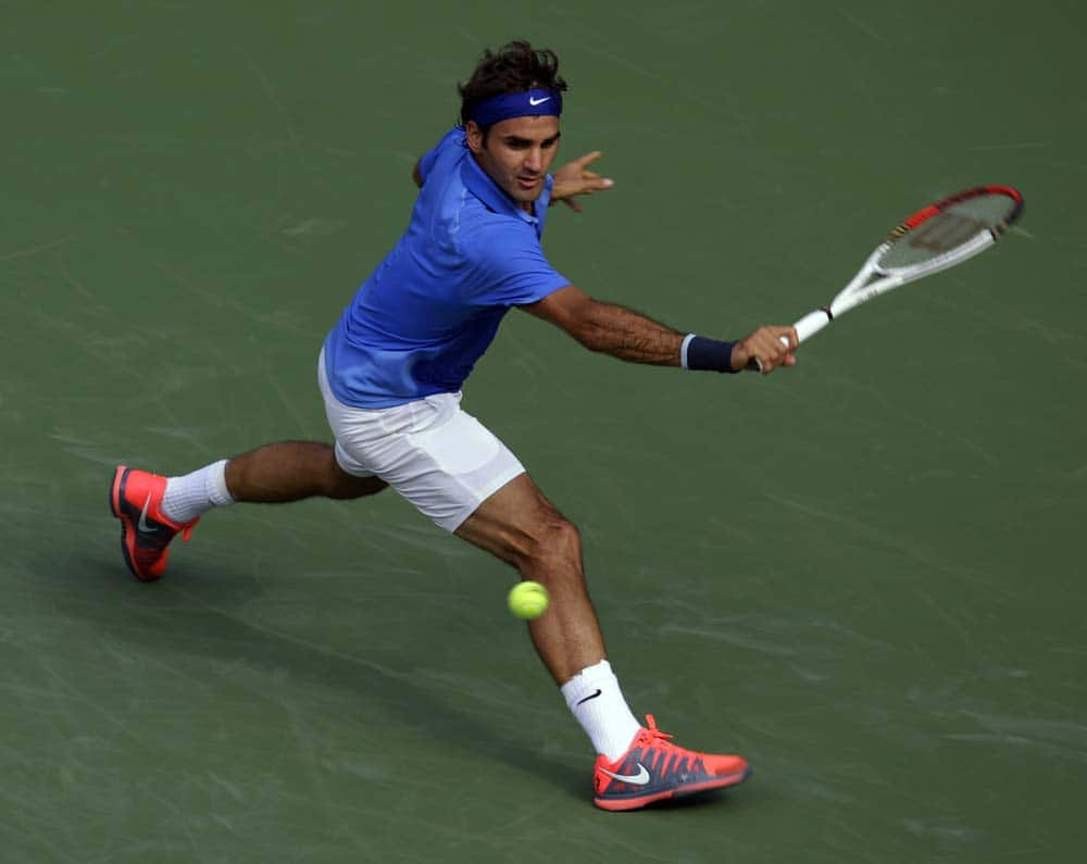 Roger Federer, of Switzerland, returns a shot to Carlos Berlocq, of Argentina, during the second round of the 2013 US Open tennis tournament.