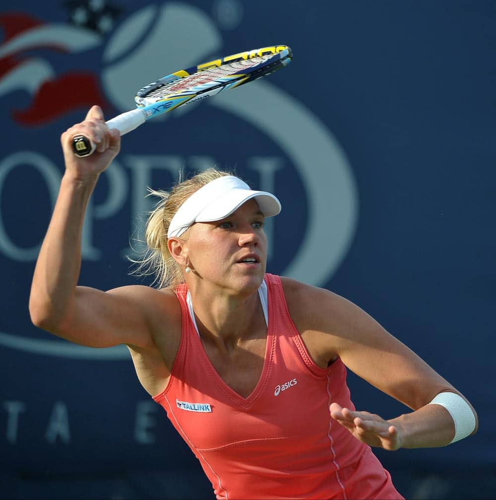 Kaia Kanepi of Estonia returns a shot against Angelique Kerber of Germany during the third round of the 2013 US Open tennis tournament.
