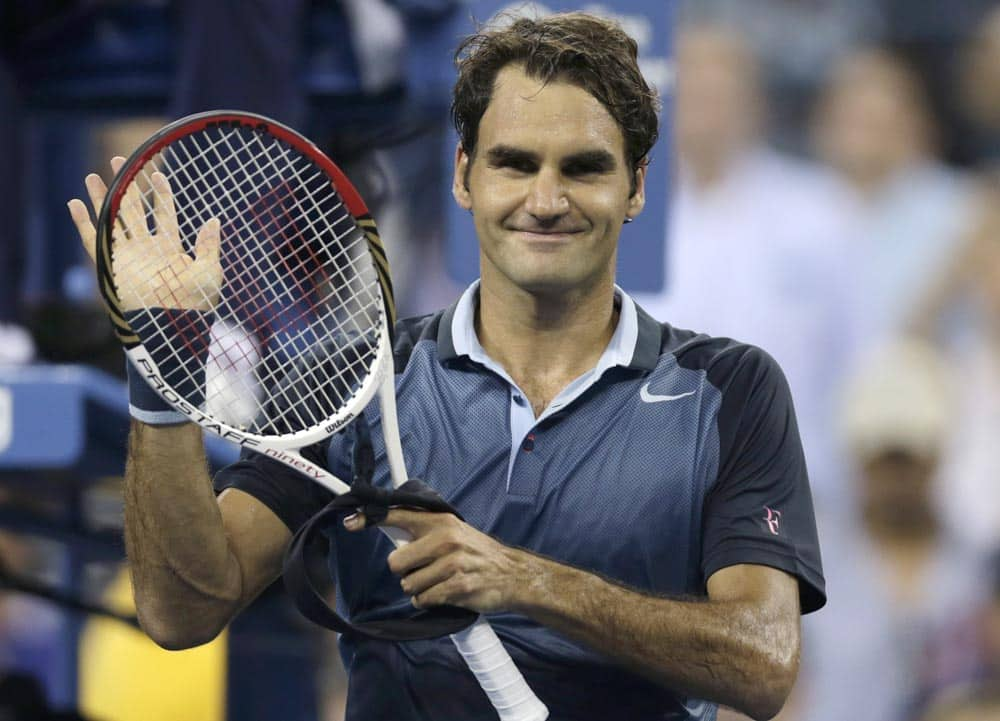 Roger Federer, of Switzerland, thanks fans after defeating Adrian Mannarino, of France, during the second round of the 2013 US Open tennis tournament.