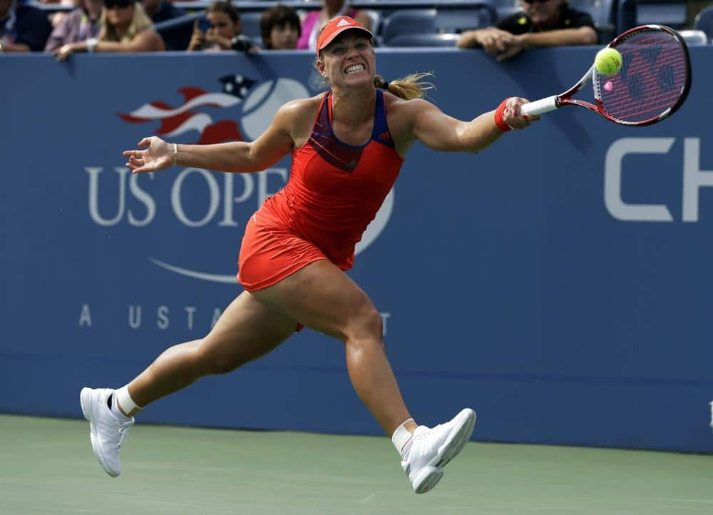 Angelique Kerber, of Germany, returns a shot to Carla Suarez Navarro, of Spain, during the fourth round of the 2013 US Open tennis tournament.