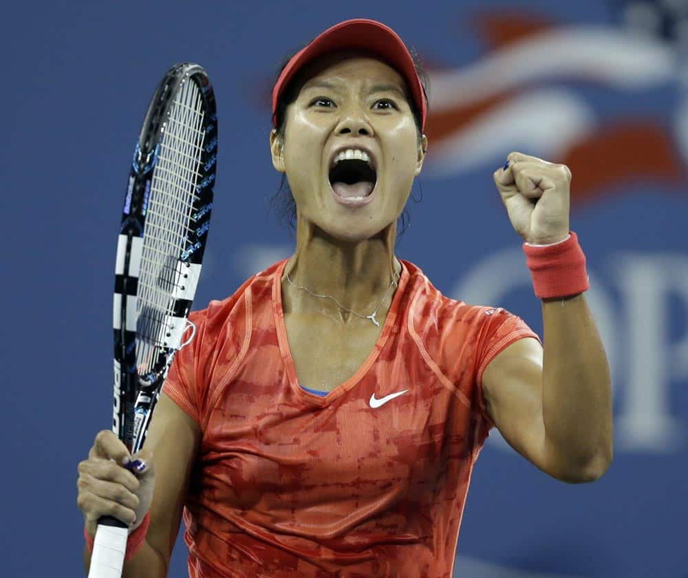 Li Na, of China, reacts after defeating Jelena Jankovic, of Serbia, in a fourth round match at the US Open tennis tournament.