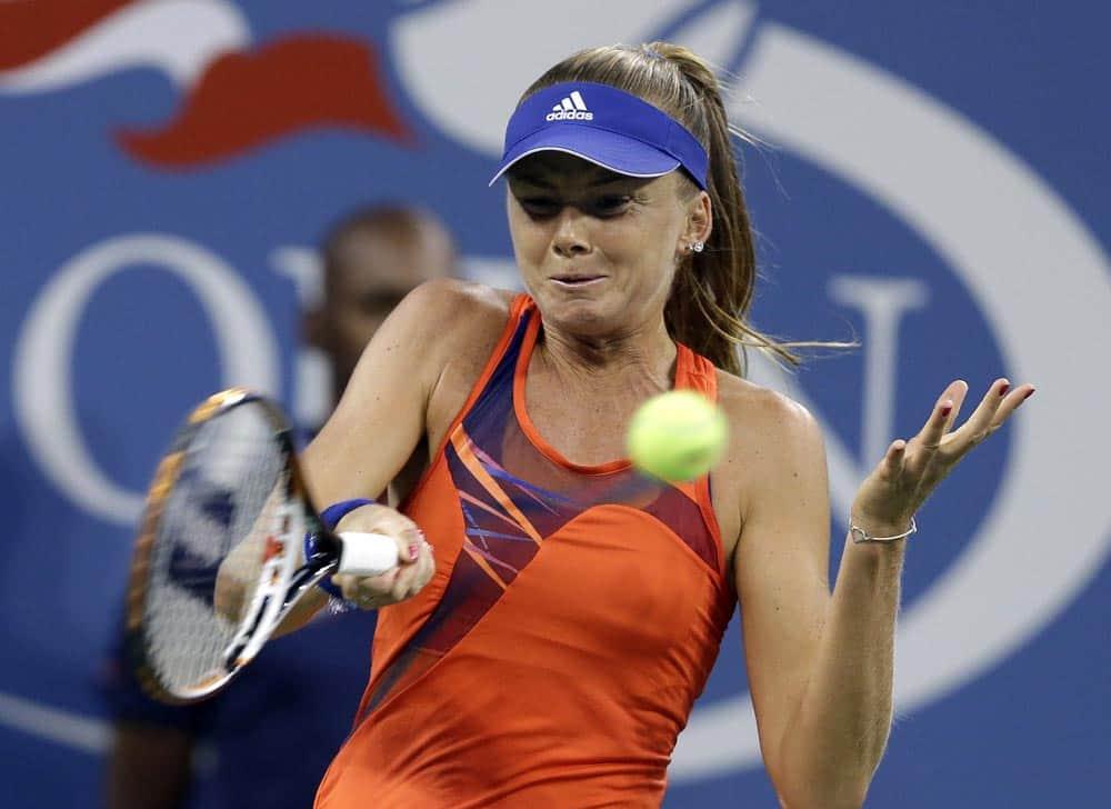 Daniela Hantuchova, of Slovakia, returns a shot to Victoria Azarenka, of Belarus, during a quarterfinal in the US Open tennis tournament.
