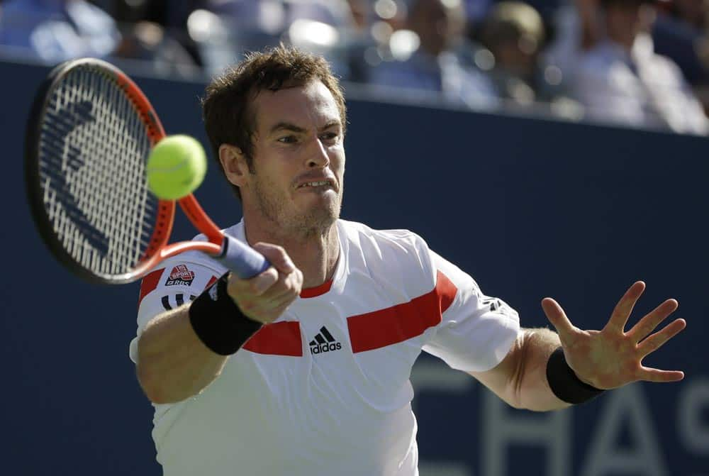 Andy Murray, of Great Britain, returns a shot to Stanislas Wawrinka, of Switzerland, during the quarterfinals of the 2013 US Open tennis tournament.