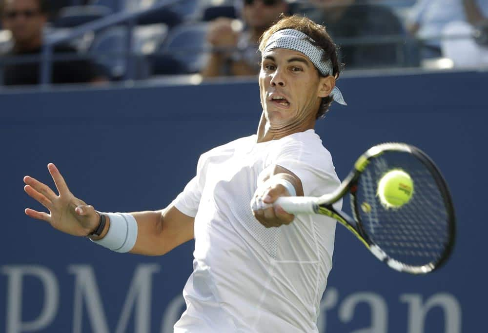 Rafael Nadal, of Spain, returns a shot against Richard Gasquet, of France, during the semifinals of the 2013 US Open tennis tournament.