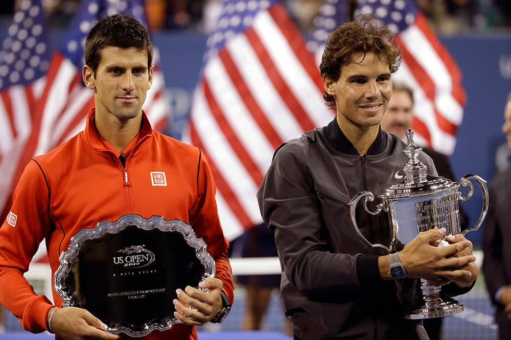 Novak Djokovic, of Serbia, and Rafael Nadal, of Spain, pose for photos after Nadal won the men's singles final of the 2013 US Open tennis tournament.