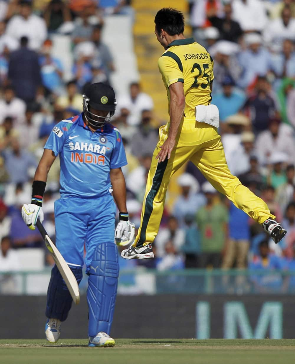M Johnson exults after taking wicket of Indian batsman Yuvraj Singh (L) during their 3rd ODI cricket match at PCA stadium in Mohali.