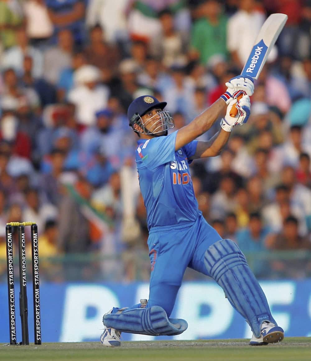 MS Dhoni plays a shot against Australia during the 3rd ODI cricket match at PCA stadium in Mohali.