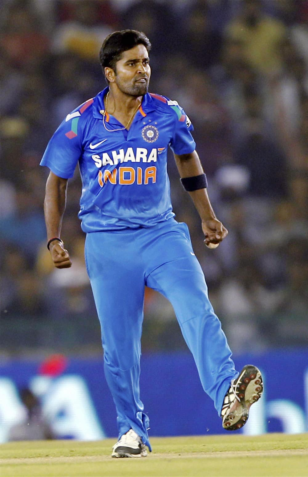 R Vinay Kumar of India reacts after taking the wicket of Australian batsman PJ Hughes during the 3rd ODI match at PCA stadium in Mohali.
