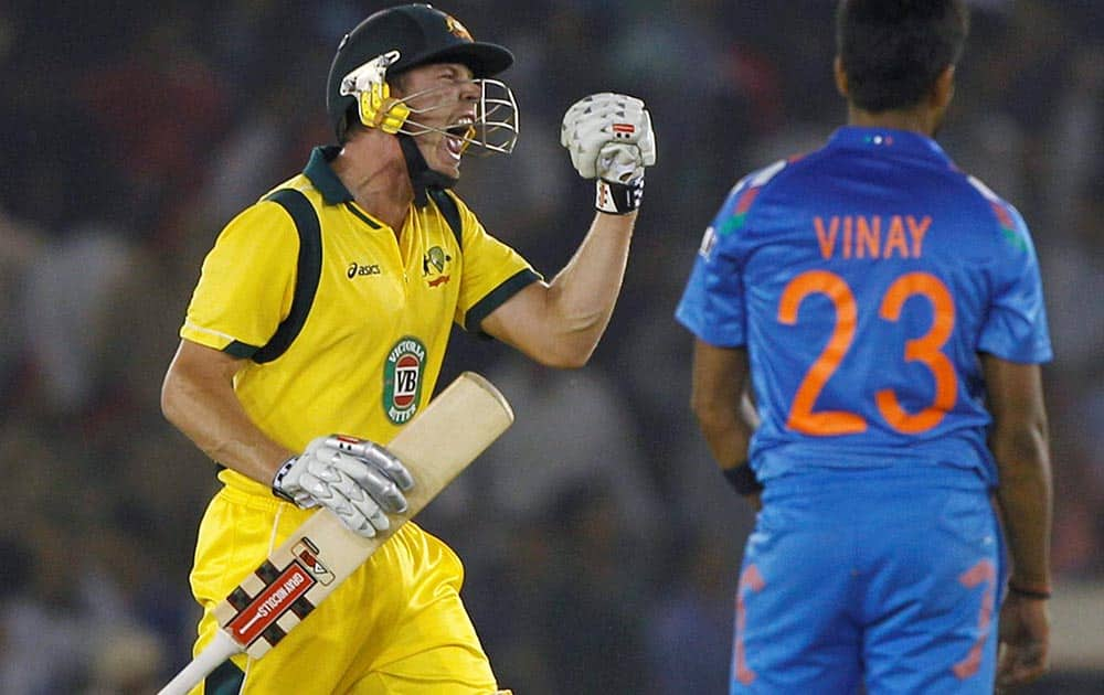 Australian batsman Faulkner reacts after hitting the winning shot against India during the 3rd ODI at PCA stadium in Mohali.