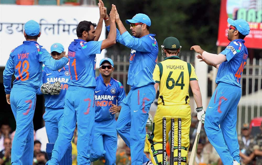 M Shami celebrates with teammates after claiming the wicket of Australia's A Finch during the 4th ODI cricket match in Ranchi.