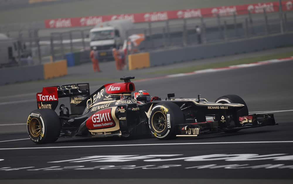 Lotus driver Kimi Raikkonen of Finland steers his car during the third practice session at the Indian Formula One Grand Prix at the Buddh International Circuit in Noida.