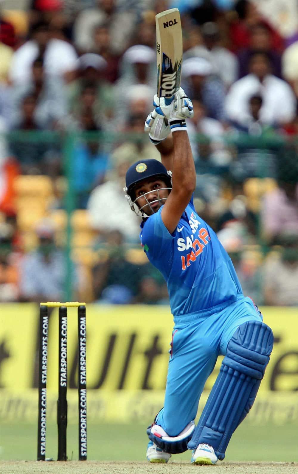 Rohit Sharma plays a shot during the 7th ODI cricket match against Australia at Chinnaswamy stadium in Bengaluru.