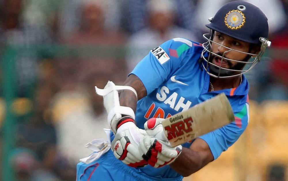 Shikhar Dhawan plays a shot during the 7th ODI against Australia at Chinnaswamy stadium in Bengaluru.