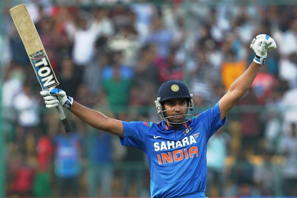 Rohit Sharma celebrates his double century during the 7th ODI against Australia at Chinnaswamy stadium in Bengaluru.