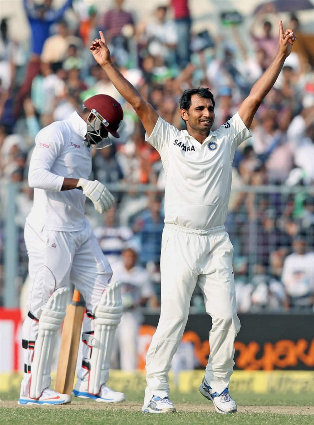 Mohammed Shami after taking the last wicket on the first day of the first test match between India and West Indies at Eden Garden in Kolkata.