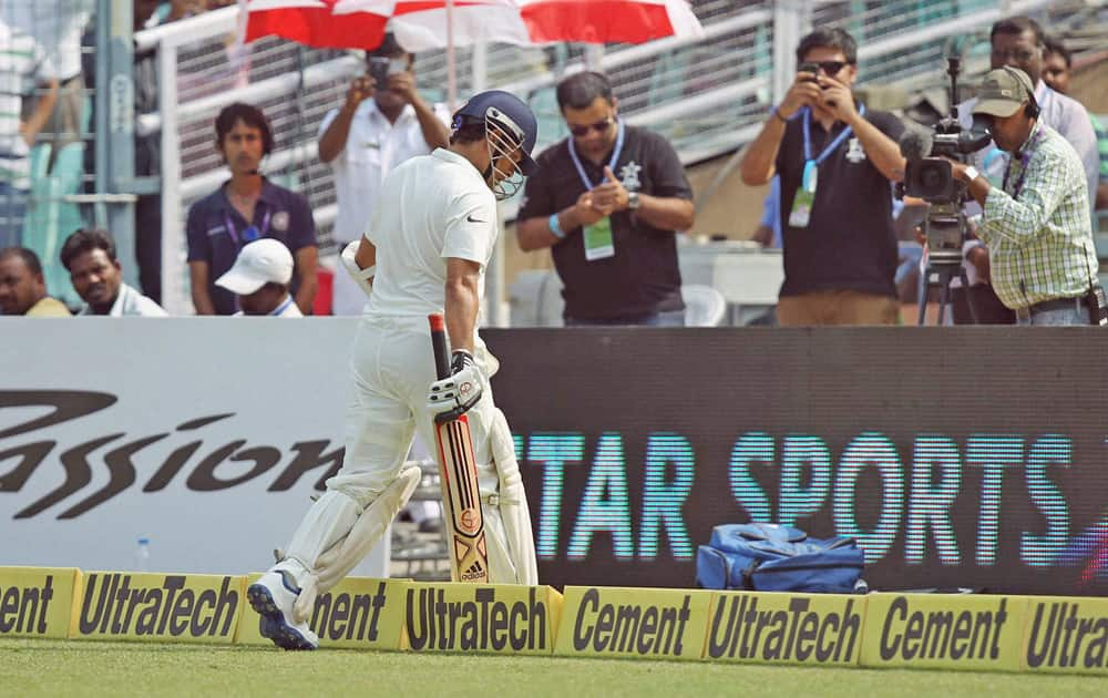 Sachin Tendulkar walks out after being dismissed.