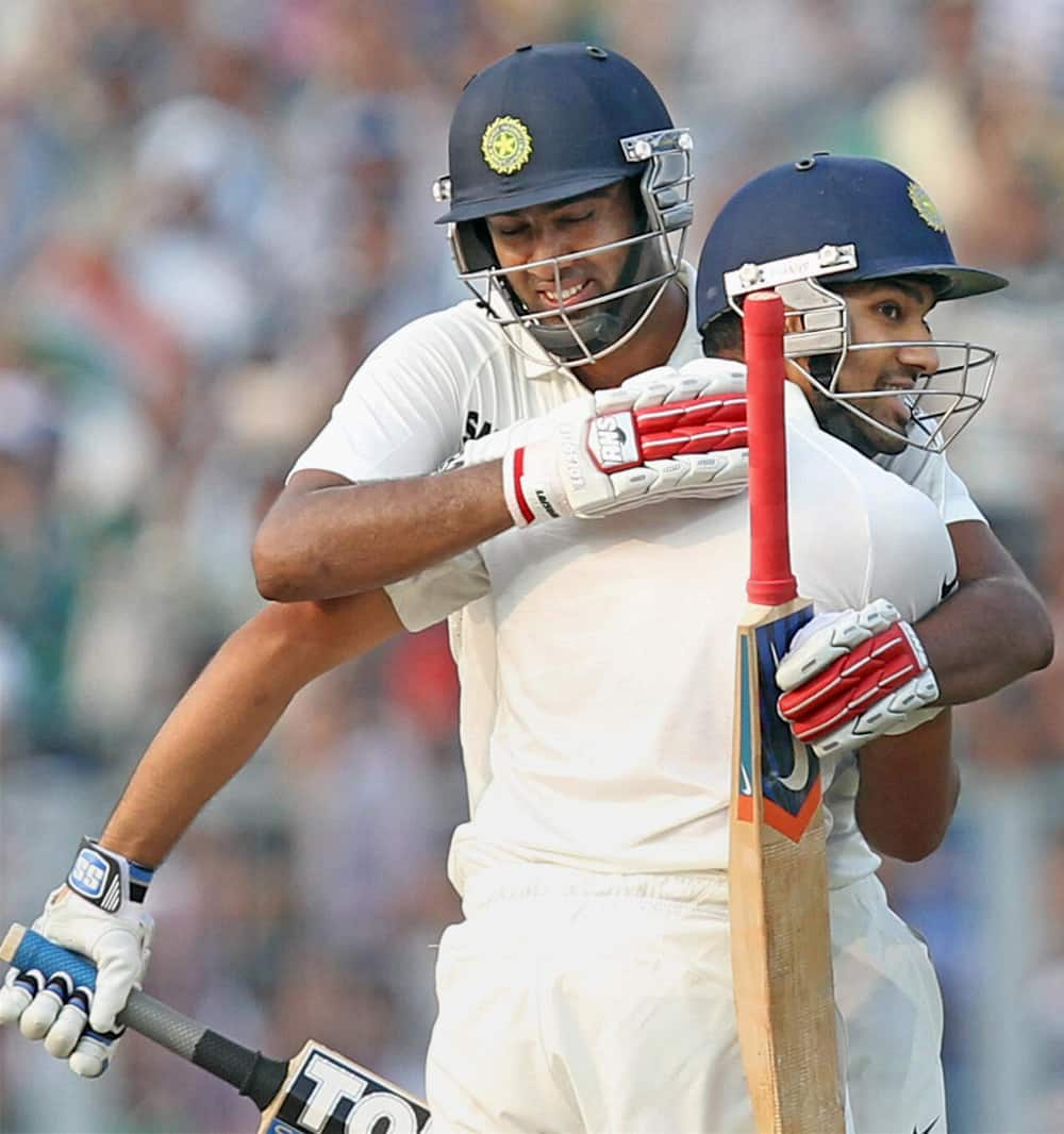 Rohit Sharma is congratulated by his teammate R Ashwin after scoring a century during Frist Test match 2nd day againist West Indies in Kolkata.