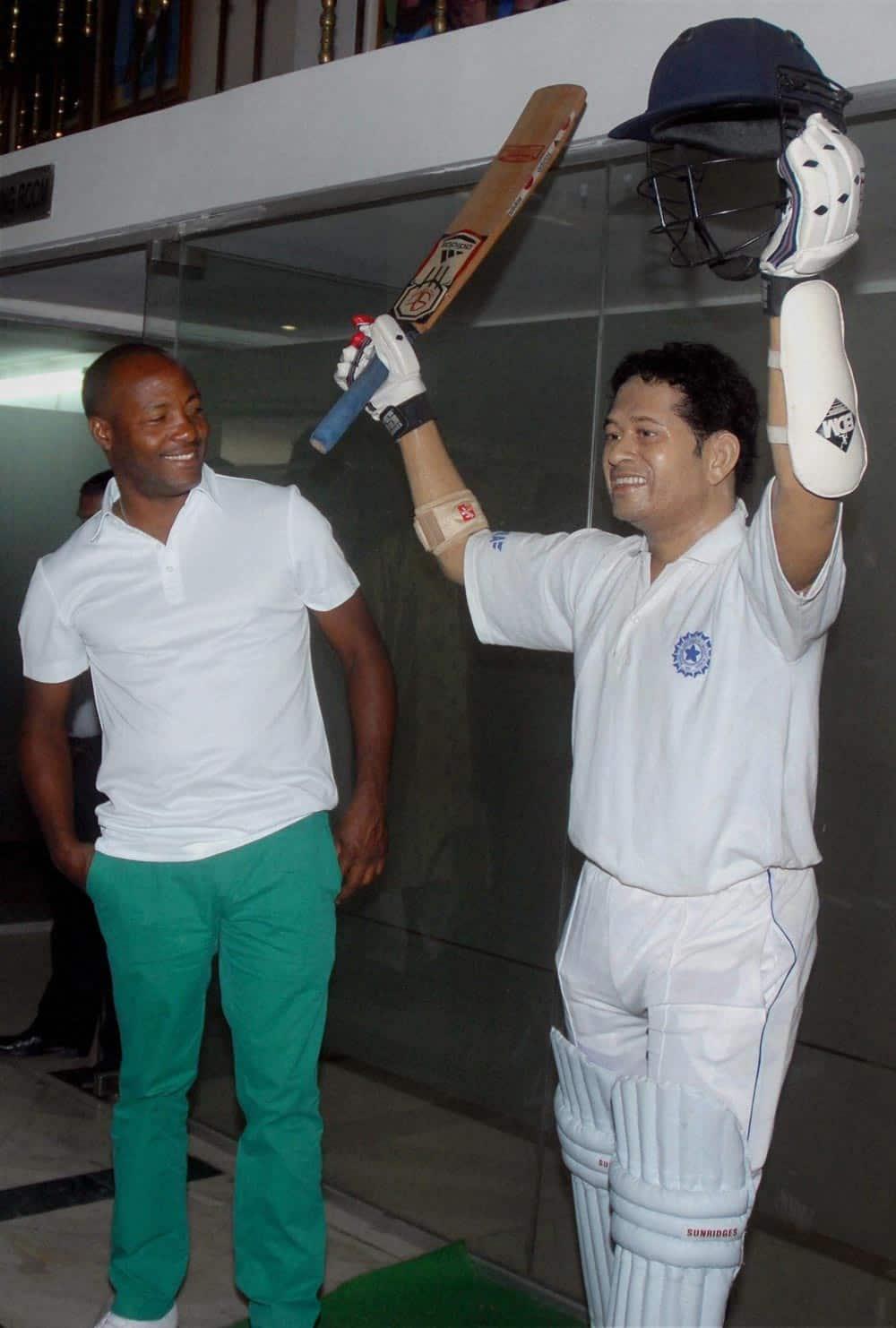 Former West Indian cricketer Brian Lara looking at the wax statue of Master Blaster Sachin Tendulkar at Eden Gardens in Kolkata.